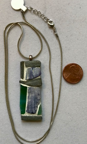 "Natural stone, stained glass and shell pendant, 2"" x 3/4"", with silver chain, 24"" $45.00"